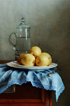 "<a href=""http://nikolay-panov.pixels.com/products/asian-pears-nikolay-panov-art-print.html"">nikolay-panov.pix...</a> classic still life with few yellow Asian Pears on blue folded napkin and tall pitcher with water in old kitchen"