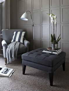 The Club footstool is a contemporary style and fits in well with just about any style of sofa or armchair. This large square footstool is shown in a dark grey wool but also is available in other colours and textures such as velvet, linen cotton, and more.