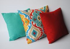 Three indoor/outdoor ikat print pillow covers by ThatDutchGirlHome