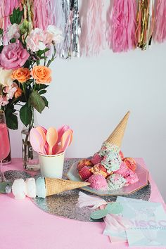 Bright bridal shower decor idea - ice cream bridal shower with pink, white + gold tassels, flowers and ice cream {Courtesy of Glitter Guide}