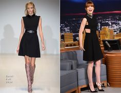 Emma Stone in a Gucci Fall 2014 black mini dress featuring leather epaulettes, cut-out sides and a pleated skirt.  WANTS IT SO BAD.
