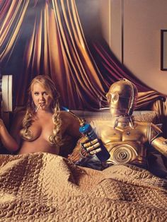 "Amy Schumer is GQ's August covergirl, dressed up in a ""Star Wars"" slave Leia bikini costume and sucking some droid finger. Inside, the comedian is posed in bed with C-3PO and R2-D2. We're pretty sure that never happened in the movie, but what a lucky lady, right?"
