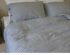 Navy and white striped duvet cover with wood buttons closure