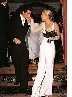 one of my favorite shots is this intimate moment with JFK Jr leaving a small chapel with his new bride