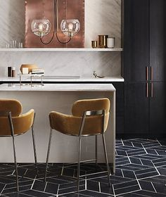 wrap around. Designed by Caleb Zipperer and curved with two tiers of comfort. Retro champagne-colored bar stool invites guests to stay and sip a while. Sits plush with bottom tier sized right for arm resting. CB2 exclusive.