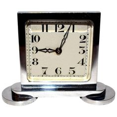 Original 1930s Art Deco Miniature Chrome Clock | From a unique collection of antique and modern clocks at https://www.1stdibs.com/furniture/decorative-objects/clocks/