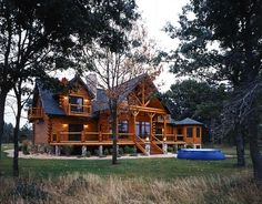 modern cabin, Golden Eagle Log Homes This log mansion, and everything inside it look awesome
