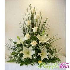 Symmetrical floral arrangement containing white roses Arrangements Funéraires, Funeral Floral Arrangements, Church Flower Arrangements, Beautiful Flower Arrangements, Beautiful Flowers, Simply Beautiful, Beautiful Pictures, Altar Flowers, Church Flowers