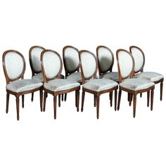 Set of Eight 19th Century French Directoire Walnut Dining Chairs | See more antique and modern Dining Room Chairs at https://www.1stdibs.com/furniture/seating/dining-room-chairs