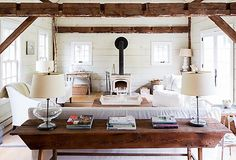 Chilly sea breezes. Weathered gray dunes. Laid-back  evenings spent by the fire. There's a quiet beauty to the  beach in winter. Channel the coastal style with a pared-  down palette, cozy textures, and natural accents, and shop  our finds to create a cool-weather escape of your own.  Photo by Ball & Albanese
