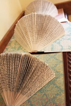 Folded and fanned books on gorgeous paper. I would love to do this as wall art. Handmade Flowers, Diy Flowers, Wedding Flowers, Book Centerpieces, Beaded Bouquet, Honey Favors, Our Wedding, Wedding Ideas, Types Of Books