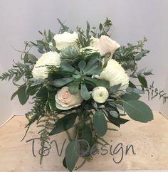 Lush bridal bouquet with plumosa, seeded eucalyptus, gunnii eucalyptus, succulents, roses, football mums, and runuculus.