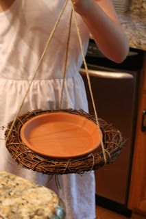 On Friday I teased you with this sneak peek of our weekend craft project. This is all you need to make a birdbath for your feathered friend...
