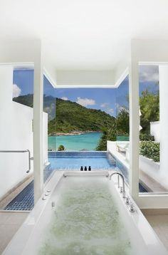 Soaking Tub + hot tub looking over the water-aahhhh
