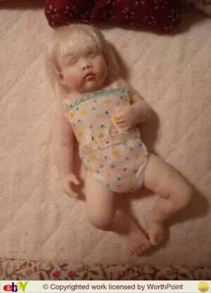 Susan Scogin porcelain.  Susan transformed this into my pageant baby!