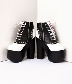 A vintage vibe for a punk rock wardrobe! A criminal pair of soft vegan leather ankle boots, perfect for taking your trouble making spirit to the next level. Crafted in man made materials, with a black and white saddle design, with a front lace up detail,