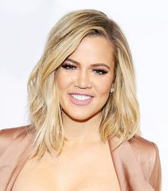 Khloé Kardashian's textured waves and extra long lashes are so stunning