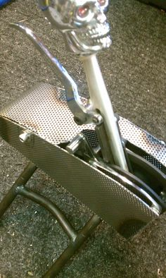 Perforated steel shifter cover and chromoly frame.  The skull is mandatory...
