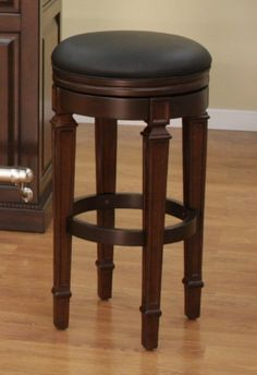 """Oxford Bar Stool Suede with Black Vinyl by American Heritage Billiards. $169.95. Backless barstool. Ships KD. Length 16. Floor glides. Comfortable 3"""" cushion. The perfect stool to compliment your space. This classic backless gem has a 3"""" cushion and 360 degree swivel for excellent comfort and functionality. Ample seating for many hours of conversation. Width 16Medium LightMaterial WoodHeight 31"""