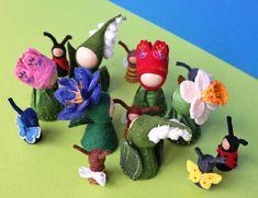 Waldorf inspired flower pegdolls in embroidered felt clothes