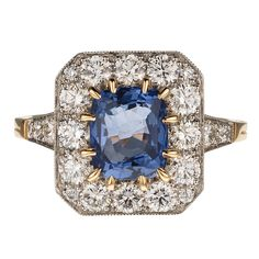 French Sapphire Diamond Gold Cluster Ring | From a unique collection of vintage engagement rings at https://www.1stdibs.com/jewelry/rings/engagement-rings/