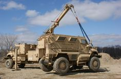 Using a MaxxPro MRAP Recovery Vehicle (MRV) to lift a MaxxPro Dash DXM MRAP
