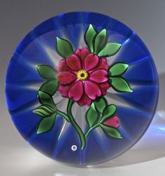 "Bob Banford paperweight - Fantasie Flower over blue ground w star cut base. 1988, 3""w x 2 1/4""t, 16.8 oz. - #0763"