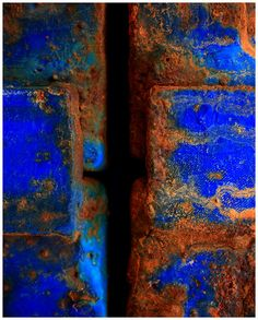 blue contrasting with the orange rust
