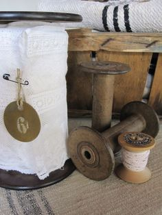 Wooden spools and lace