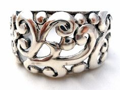 Sterling Silver Wide Open Work Ring Size 9 Band Fine Jewelry Rings 925     This is a wide sterling silver open work design ring.     It is a size 9, hallmarked 925, measures almost .38 inch at widest point and weighs a 4.9 grams.