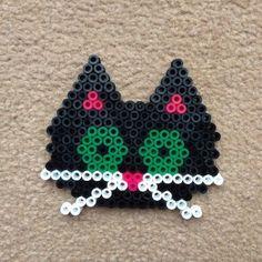 Little kitten face in Hama Beads on Hexagon pegboard.by Merrily Me