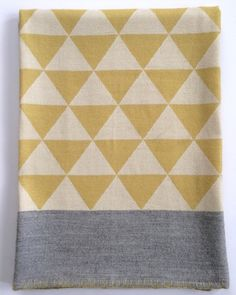 Stockholm Throw - woven in Peru and inspired in Sweden.  Citrus and Heather Grey.