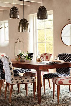 Elza Ikat Dining Chair - anthropologie.com Mixed upholstery adds interest here.