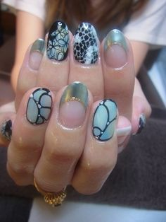 Light blue, black and silver nails.