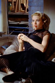 Grace Kelly (Rear window).......FIRST TIME I'VE EVER SEEN HER WITH A CIGARETTE.........ccp