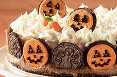 Chocolate and vanilla ice creams layered in a crumb crust are decorated with sandwich cookies, whipped topping and candies for a Halloween treat.