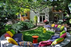 Awesome Decoration Outdoor Living Space With Colorful Cushions In Modern Round Shape Sofa Outdoor Furniture Under Tree Dashing Outdoor Plan Living Spaces Surrounding by City Light Home design
