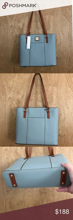 """Dooney & Bourke Pebble Grain Small Lexington NWT Dooney & Bourke Pebble Grain Small Lexington Shopper in Heather Blue. NWT. Authentic Dooney Shopper is in beautiful pebble leather. Hard to find Heather Blue/Gray color with brown leather accents. Two exterior slip pockets. Zip top closure with braided leather zipper pull. Interior backwall zip & slip pocket and frontwall has two slip pockets an a key keeper. Measurements: 10.5""""H x 11.75""""L x 3.5""""D. Strap drop 11.5"""". Small mark on right edge…"""