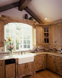a rustic kitchen with vintage-inspired wooden cabinets and stone countertops