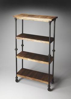 Crafted from iron finished in an epoxy gray and solid-wood planks, this unconventional Bookcase on wheels provides a compelling showcase for large books and tall decorative accessories. Dimensions: 31