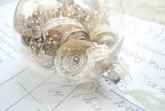 Ornaments filled with curled book pages and glitter. I made a version of these last Christmas with vintage sheet music. (Thanks Peg for the pages!) I got the idea from The Vintage Farmhouse blog.