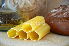 pasta, bread and a bottle of oil