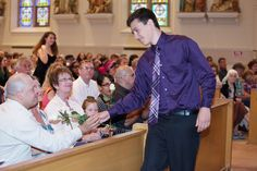 Parents and families received roses for the strong support they gave their 2013-14 8th grade graduates