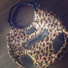 """Kate Spade New York Shoulder Bag Kare Spade New York Shoulder Bag. Tan Nylon Shoulder Bag, Leopard with Leather Trim, Zipper Pocket in Front, Red Polka Dot Lining, Zipper Pocket in Center and Inside Back, Two open Pockets Inside Front, One Small Mark in Front As Pictures, Lightly Used, Shoulder Strap Drop 9"""", Height 9.25"""", Width 15"""" kate spade Bags Shoulder Bags"""
