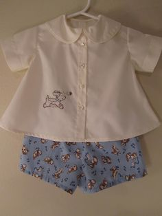 For this outfit, I used another pattern from Creations by Michie', called Diaper Shirt and Shorts, I loved the puppy fabric. Baby Girl Dress Patterns, Baby Clothes Patterns, Clothing Patterns, Baby Dress, Sewing Patterns, Skirt Patterns, Coat Patterns, Blouse Patterns, Little Boy Outfits