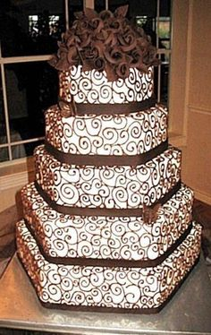 Five tier wedding cake with beautiful scrollwork and chocolate roses.  ᘡղᘠ