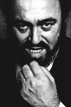 Luciano Pavarotti - opera singer (1935-2007). This man was and always will be a god among opera singers. I would give anything to have been able to see him perform live!