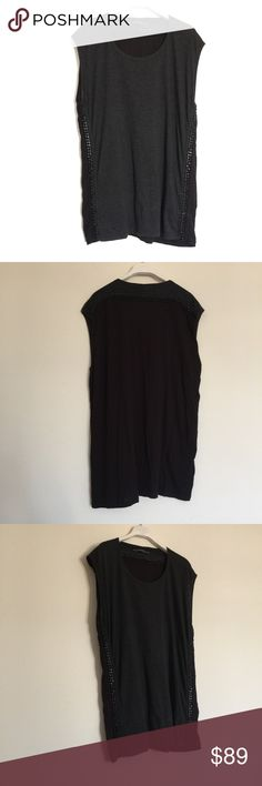 """All Saints grey black sleeveless chain tunic top 4 Great condition. Scoop neck with chain embellished sides and along back. Please keep in mind this top is on the heavy side due to the quality of the heavy chain. Front is grey and back is black. Pit to pit 21"""", length 27"""". 50% polyester, 38% cotton, 12% viscose. All Saints Tops"""