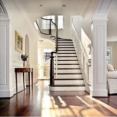 "2,038 Likes, 71 Comments - Christian Daw (@christiandawdesign) on Instagram: ""Here's another beautiful #entryway 💁🏻‍♂️ This one's from a typical DC #centerhall #colonial 💙 Love…"" #entryway #foyer #stairs #white #railing #hardwood #hallway #interiors #lighting #pillars #moulding"