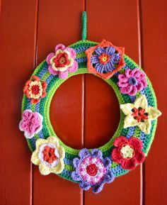 Fly the Coop Crafts: Springy Flower Wreath in Crochet- Beautiful design with fantastic flowers in and of themselves!